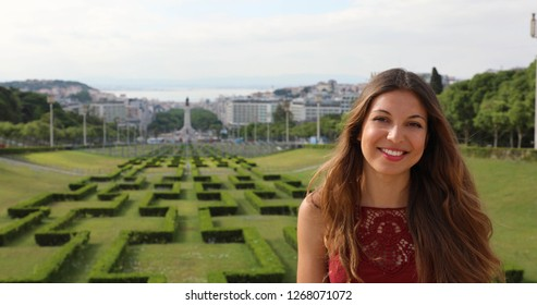 Attractive young woman with long hair in Eduardo VII park, Lisbon, Portugal