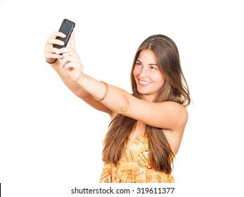 attractive young woman with long hair takes a selfie