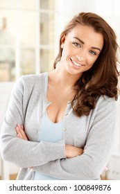 Attractive young woman looking at camera and smiling