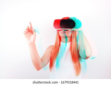 attractive young woman looking through virtual reality headset, pointing up, indoor shot over white background. caucasian female model wearing VR goggles. 3D anaglyph effect, glitch art.