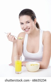 Attractive young woman lunching on white background