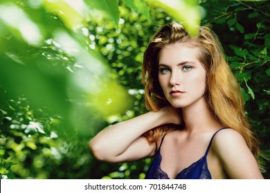 Attractive young woman with magnificent long hair posing outdoor. Beauty, fashion concept.