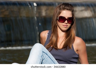 Attractive young woman near Fountain