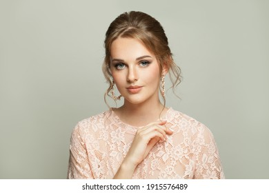 Attractive young woman on gray background