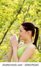 Attractive young woman outdoor with white tissue. Allergy concept.