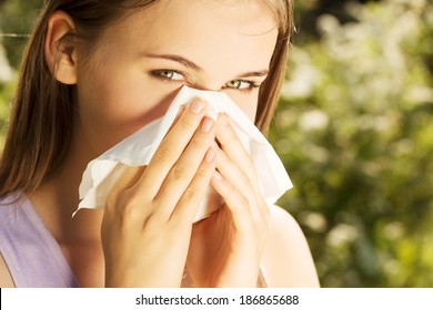 Attractive young woman outdoor with white tissue.