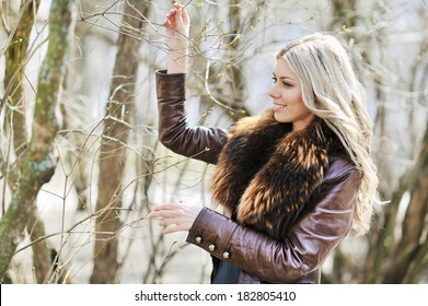 Attractive young woman playing with tussock in spring