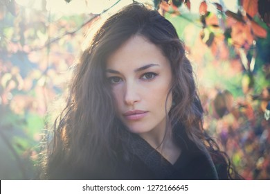 attractive young woman portrait in forest winter day sunset closeup