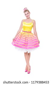 Attractive young woman posing in colorful lush dress. Isolated on white