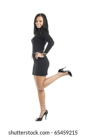 Attractive young woman posing in short pretty black dress