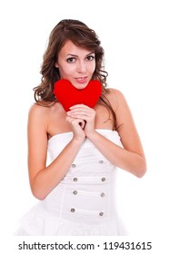 Attractive young woman with red heart in hand, white background