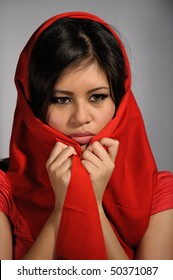 Attractive young woman with red scarf