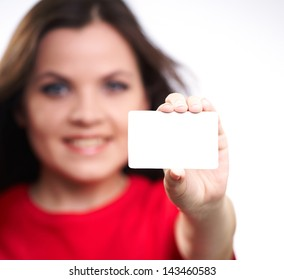 Attractive young woman in a red shirt. Holds a poster. On a white background