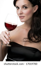 Attractive young woman with red wine