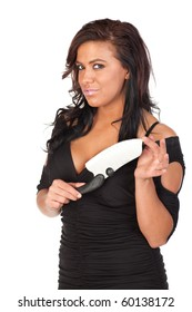 An attractive young woman in a sexy black dress, holding a large kitchen knife, with a sly look on her face.