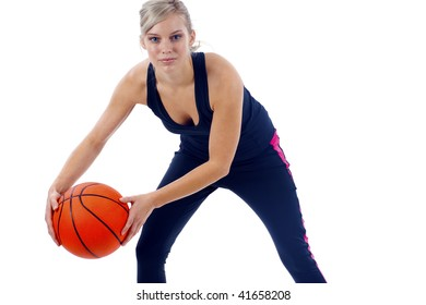 Attractive young woman shooting a basketball isolated over white background