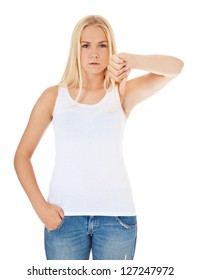 Attractive young woman showing thumbs down. All on white background.