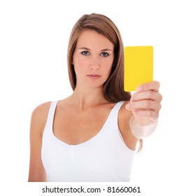 Attractive young woman showing yellow card. All on white background.