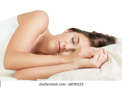 Attractive young woman sleeping against white background