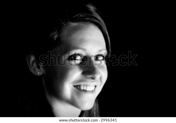 Attractive Young Woman Smiling – Close-up Black & White (shallow focus)