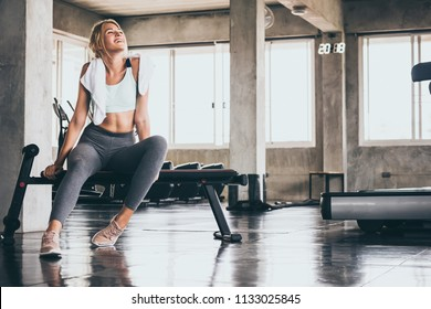 Attractive young woman taking a break after exercise at the gym
