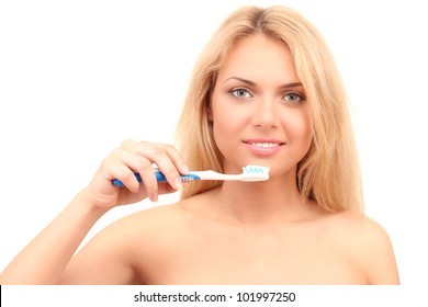 Attractive young woman with a toothbrush on white background close-up