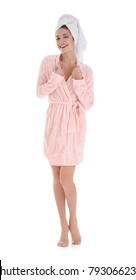 Attractive young woman in towel and bathrobe on white background