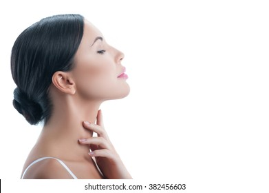 Attractive young woman is treating her body