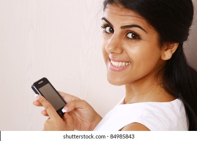 Attractive young woman using mobile phone isolated
