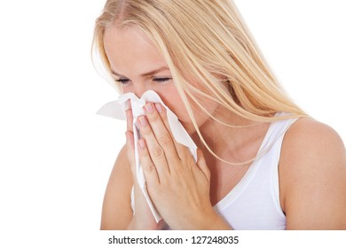 Attractive young woman using tissue. All on white background.