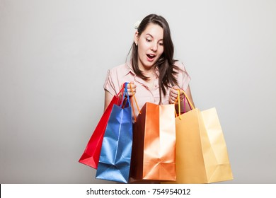 Attractive young woman is very surprised how much she bought on black friday for christmas
