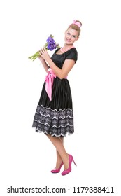 Attractive young woman wearing vintage dress posing with flowers. Isolated on white