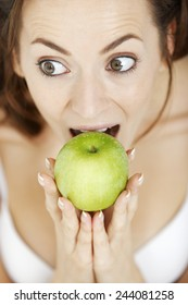 Attractive young woman in white underwear with a fresh apple