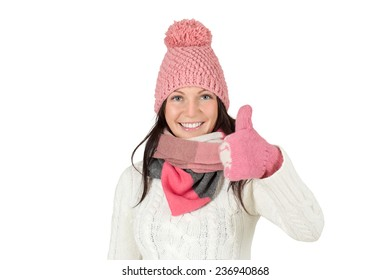 Attractive young woman in winter outfit showing thumbs up. Isolated on white background