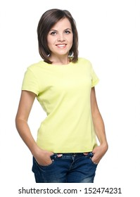 Attractive young woman in a yellow shirt and blue jeans. Isolated on white background