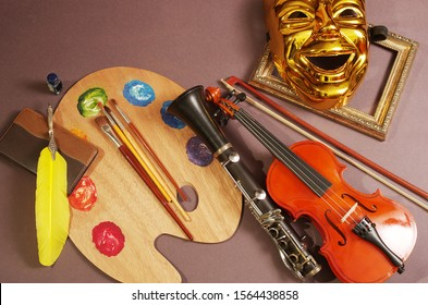 Attributes of the arts. Music, painting, literature, theater. Violin, art palette and brushes, fountain pen, notebook, theater mask.