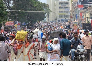 ATTUKAL, INDIA - MAR 7: Unidentified women gathered to take part in 'Pongala' ritual on March 7, 2012 in Attukal,Kerala,India.Pongala is the largest congregation of women for a festival in the world