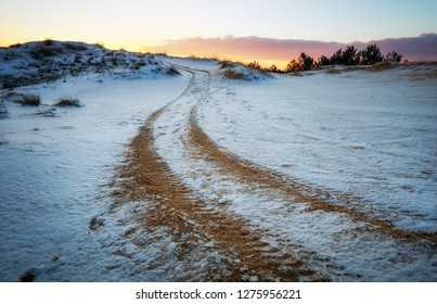 ATV auto sport track at winter. Wheel sandy tracks on snow
