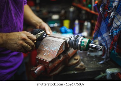 ATV constant-velocity CV joint repair by hands in old garage