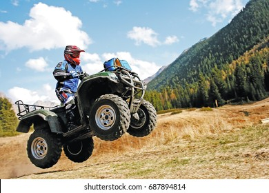 ATV jump in the mountains