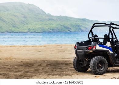 ATV on the beach. Buggy safari in the tropics
