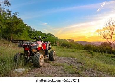 Atv on the evening mountains