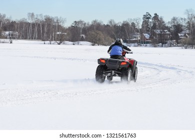 ATV on ice with snow before turning