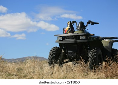 ATV parked on hill with scenic view