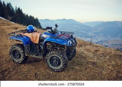 ATV Quad Bike in front of mountains landscape