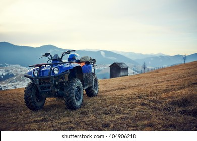ATV Quad Bike in front of mountains landscape. Selective focus