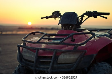 ATV Quad Bike in front of sunrise in the desert