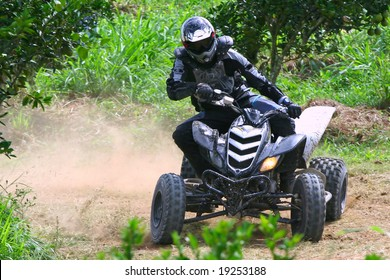 atv racing on dirt track
