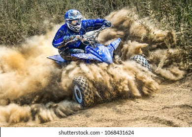 ATV rider creates a large cloud of dust