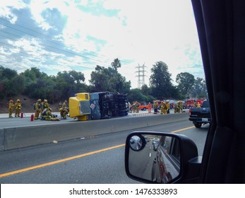 Atwater Village, California / United States -  August 7, 2019: Overturned Truck on 5 Freeway in Los Angeles Truck swerved to avoid stopped vehicle and overturned, causing spillage of gas.